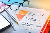 istock Ballpoint Pen Resting On Living Trust Documents 1207528742
