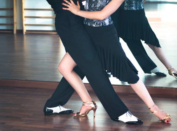 ballroom dance couple of dancers and teachers in studio school dancing in rehearsal. - tango taniec zdjęcia i obrazy z banku zdjęć