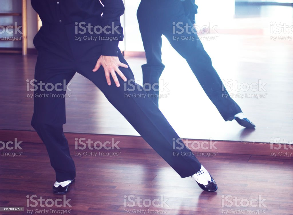 Ballroom dance male dancer and teacher in studio school dancing in rehearsal. stock photo