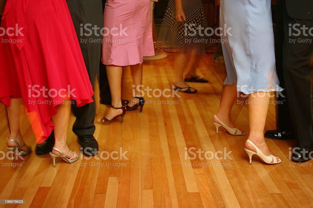 Ballroom dancing couples on hardwood floors royalty-free stock photo