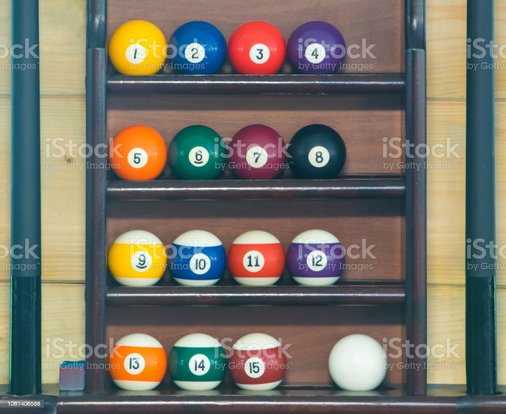 balls for billiards, stand in a row in order on the rack for storing a set of inventory for playing pool - fotografia de stock