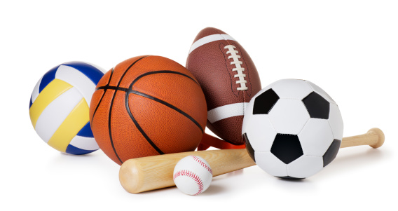 This is a photo of a variety of balls and sporting equipment isolated on a white background. There is a clipping path included with this file.