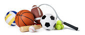 This is a photo of a variety of balls and sporting equipment isolated on a white background.