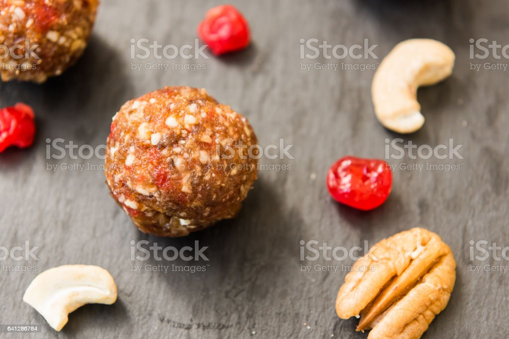 Balls made with cashews, cherries and dates stock photo