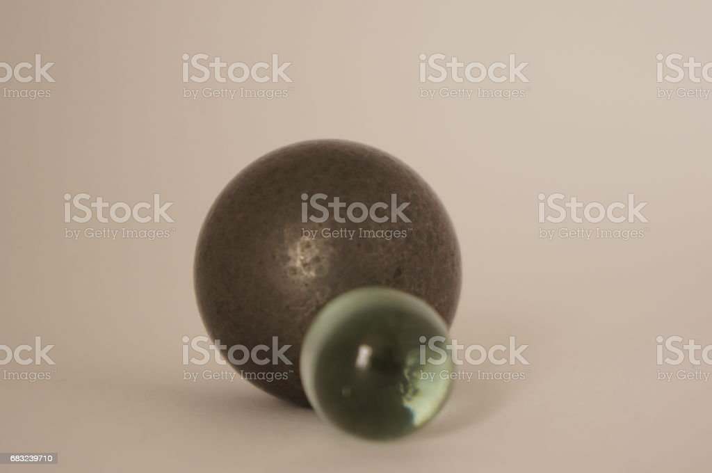 Balls of glass and iron stock photo
