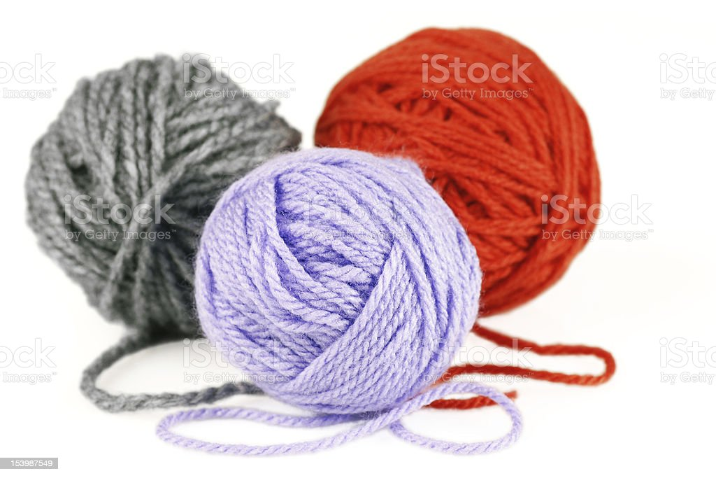 Balls of purple, orange and grey yarn or wool royalty-free stock photo