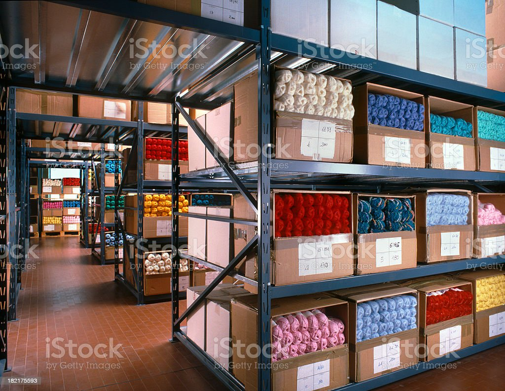 Balls of wool arranged on shelves in a textile warehouse royalty-free stock photo