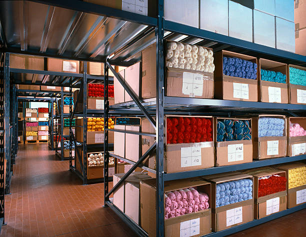 Balls of wool arranged on shelves in a textile warehouse stock photo