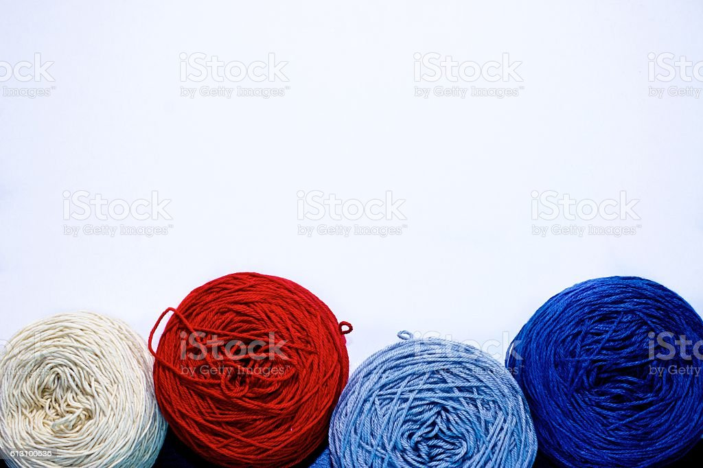 Balls of wool cotton silk yarn set on copy space stock photo