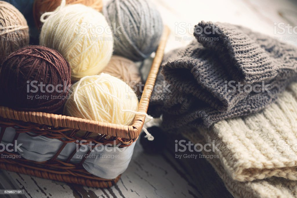 balls of wool in a basket stock photo