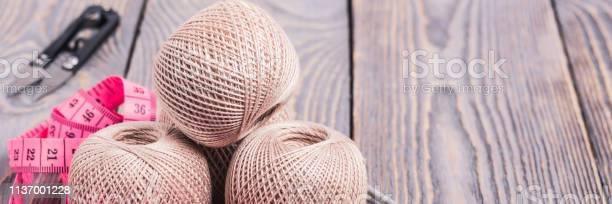 Balls of yarn knitting needles and measuring tape on a wooden picture id1137001228?b=1&k=6&m=1137001228&s=612x612&h=c7hj wyui00bi1mqt8bwoqs9117se4ee0nk5ig3ide0=