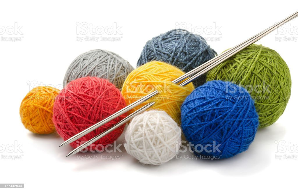 Balls of yarn with silver knitting needles royalty-free stock photo