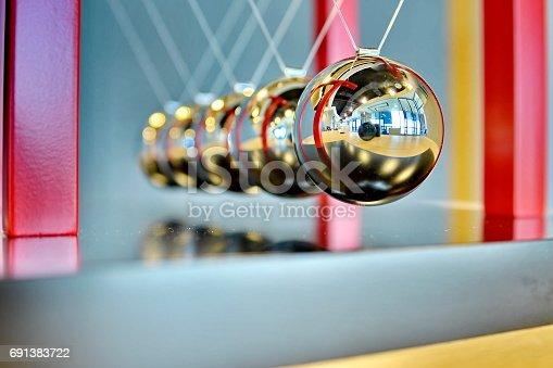 istock 5 Balls Pendulum, Newton's cradle 691383722