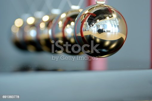 istock 5 Balls Pendulum, Newton's cradle 691383778