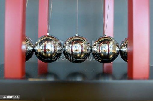 istock 5 Balls Pendulum, Newton's cradle 691384036