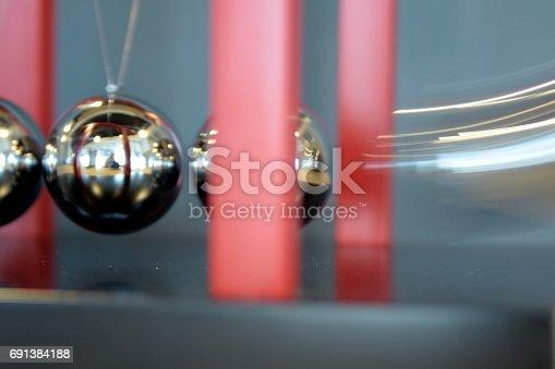 istock 5 Balls Pendulum, Newton's cradle 691384188
