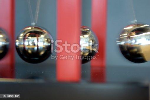 istock 5 Balls Pendulum, Newton's cradle 691384262