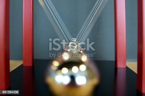 istock 5 Balls Pendulum, Newton's cradle 691384436