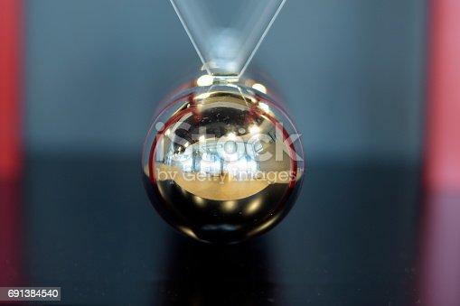 istock 5 Balls Pendulum, Newton's cradle 691384540