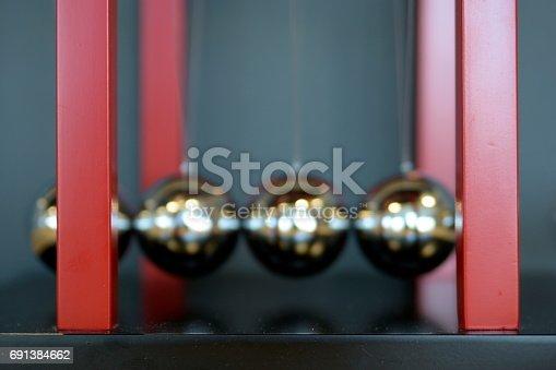 istock 5 Balls Pendulum, Newton's cradle 691384662