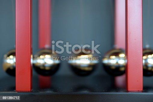 istock 5 Balls Pendulum, Newton's cradle 691384712