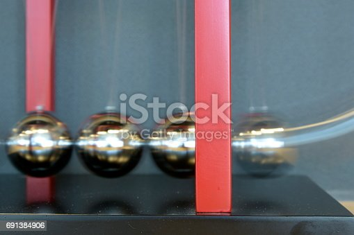 istock 5 Balls Pendulum, Newton's cradle 691384906