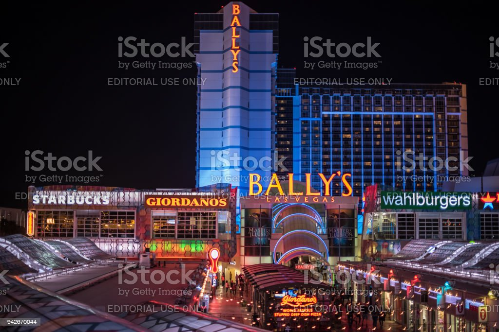 Bally's Hotel and Casino lit up at night in Las Vegas stock photo