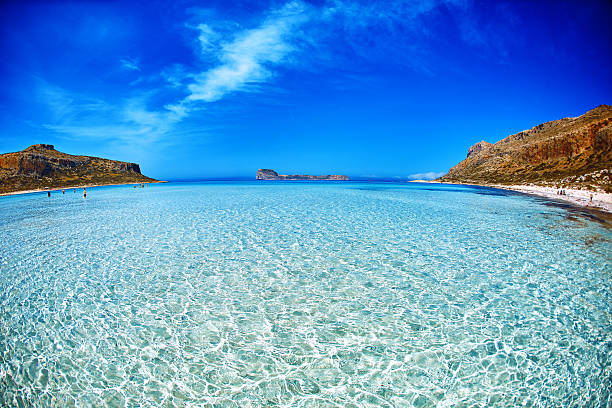 balos beach, crete. sand under water and blue sky - laguna foto e immagini stock
