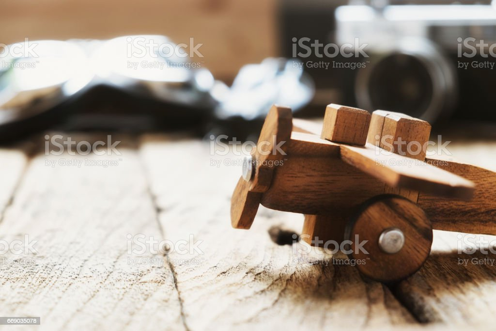 Balsa wood model airplane on desk with copy space travel concept. stock photo