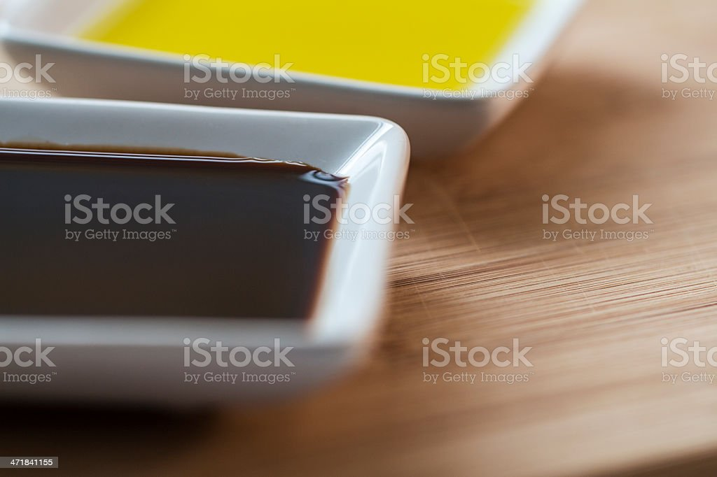 Balsamic Vinegar and Olive Oil on Serving Platter royalty-free stock photo