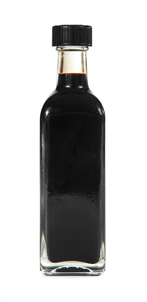Balsamic vinegar bottle on white Balsamic vinegar bottle isolated on white balsamic vinegar stock pictures, royalty-free photos & images