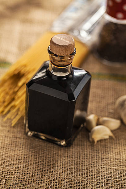 Aceto balsamico di Modena Aceto Balzamico di Modena in small glass bottle; close up, balsamic vinegar stock pictures, royalty-free photos & images