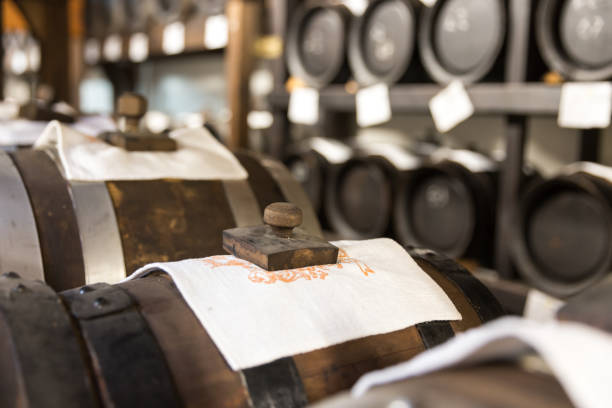 balsamic vinegar wooden barrels storing and aging balsamic vinegar barrels storing and aging balsamic vinegar stock pictures, royalty-free photos & images
