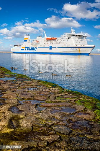 Swinoujscie, Poland - September 23, 2020: Baltic Sea ferry Nils Dacke slowly is entering the Swinoujscie harbor. Unity Line is a German shipping company that operates RoRo and train ferry services between Świnoujście in Poland and the Swedish ports of Trelleborg