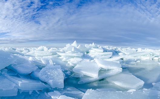 Baltic Sea on wintertime with broken ice cracks.