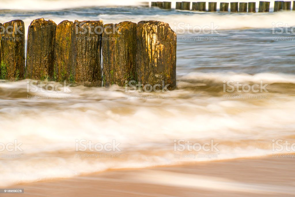 Baltic Sea with groins and surf in longtime exposure stock photo