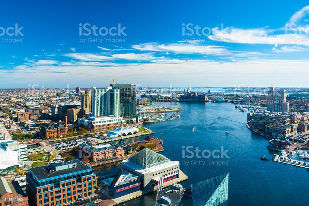 Baltimore Aerial with Patapsco River / Waterfront Aerial of Baltimore City with the Patapsco River and waterfront buildings.  Harbor East and Fells Point neighborhoods is shown on the left and the Tide Point neighborhood is shown on the right. Acute Angle Stock Photo