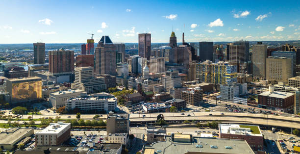 Baltimore Downtown Aerial w/ City Hall and Expressway Downtown Baltimore skyline aerial with Baltimore City Hall in the center and Jones Falls Expressway (I-83) in the foreground. baltimore maryland stock pictures, royalty-free photos & images