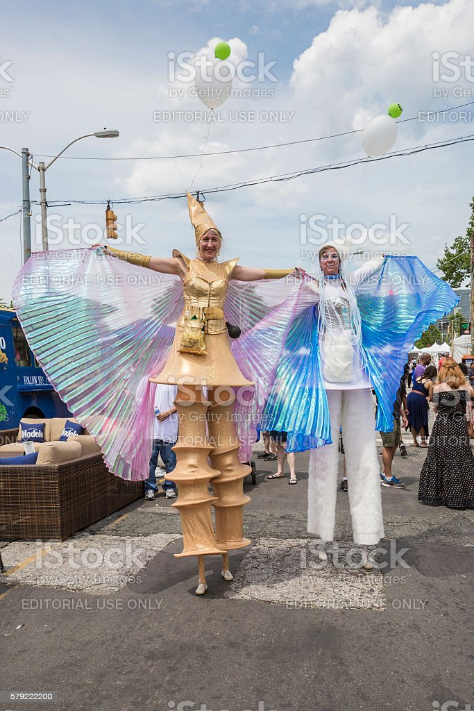 Baltimore Maryland Artscape 2016 -- Female Costumed Stilt Walkers stock photo