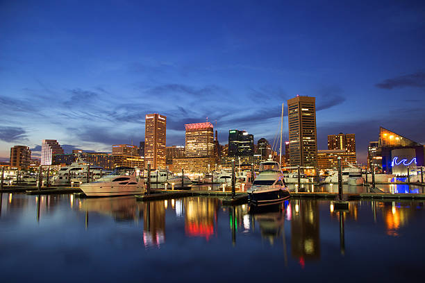 Baltimore, Maryland - Inner Harbor Baltimore's Inner Harbor during the twilight hours. inner harbor baltimore stock pictures, royalty-free photos & images