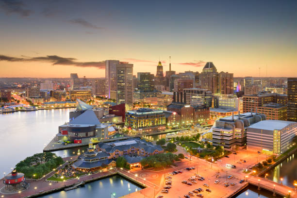 Baltimore Maryland Skyline Baltimore, Maryland, USA inner harbor and downtown skyline at dusk. inner harbor baltimore stock pictures, royalty-free photos & images