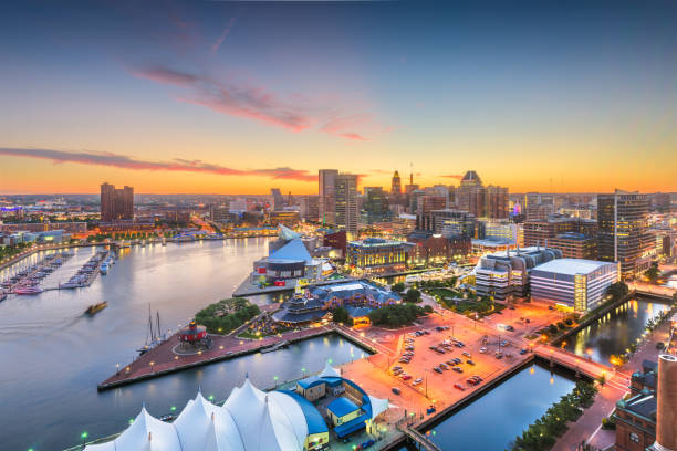 Baltimore, Maryland, USA skyline of the Inner Harbor Baltimore, Maryland, USA city skyline over the Inner Harbor at twilight. inner harbor baltimore stock pictures, royalty-free photos & images
