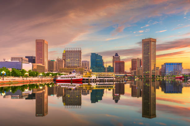 Baltimore, Maryland, USA Skyline on the Inner Harbor at dusk. Baltimore, Maryland, USA Skyline on the Inner Harbor with dramatic skies at dusk. inner harbor baltimore stock pictures, royalty-free photos & images