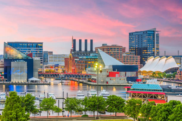 Baltimore, Maryland, USA Skyline Baltimore, Maryland, USA Skyline over the Inner Harbor at dusk. inner harbor baltimore stock pictures, royalty-free photos & images