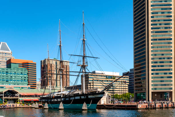 Baltimore Maryland USA - September 19, 2009: Baltimore's Inner Harbor and the USS Constellation 3 mast sloop-of-war. Baltimore's Inner Harbor Harborplace, World Trade Center and the 1854 USS Constellation 3 mast sloop-of-war. inner harbor baltimore stock pictures, royalty-free photos & images
