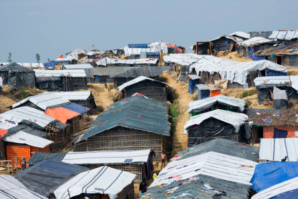 Balukhali refugee camp for Rohingyas in Bangladesh Refugees walk in the narrow lanes of crowded Balukhali refugee camp, built near Cox's Bazaar, Bangladesh, for Rohingyas from Myanmar. (October 28, 2017) rohingya culture stock pictures, royalty-free photos & images