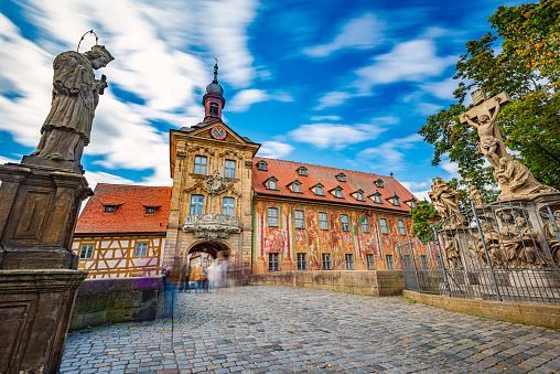 Bamberg city in Germany. Town hall building in background with blue cloudy sky.  Architecture and travel in Europe.