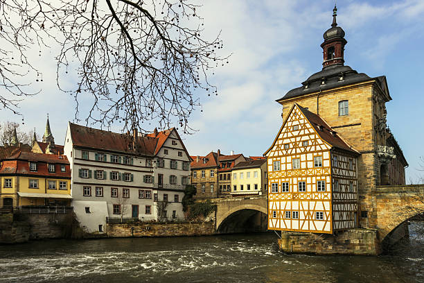bamberg, town hall and old houses at the river - bamberg stock-fotos und bilder