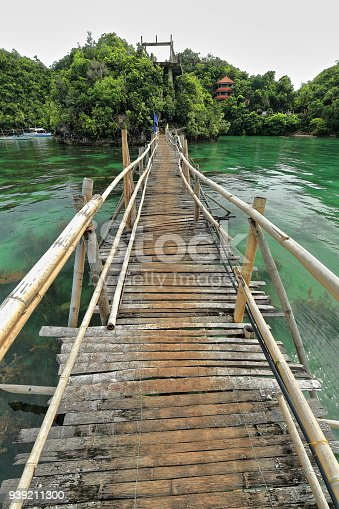 istock Bamboo and wooden planks footbridge with flags-Tinagong Dagat island. Sipalay-Philippines. 0363 939211300