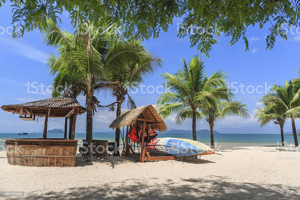 Bamboo bar on white snad beach at tropical island stock photo